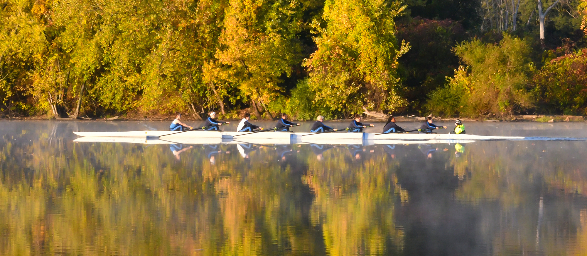 Action photo of the Lyons varsity eight boat on the Connecticut River.