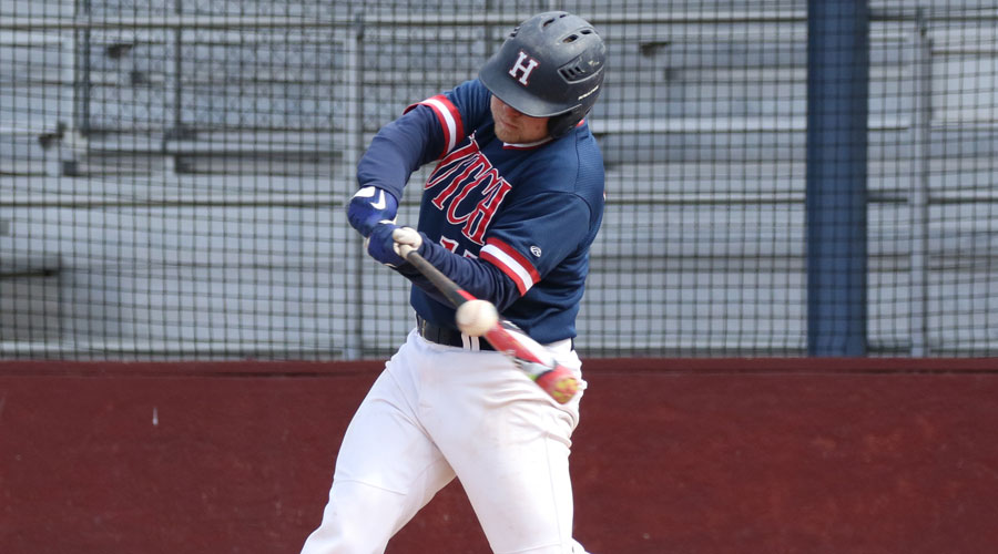 Wyatt Divis hits a three-run double that broke a tie game as No. 1 Hutchinson defeated Coffeyville 12-1 in the 2018 season opener on Thursday in Coffeyville. (Joel Powers/Blue Dragon Sports Information)