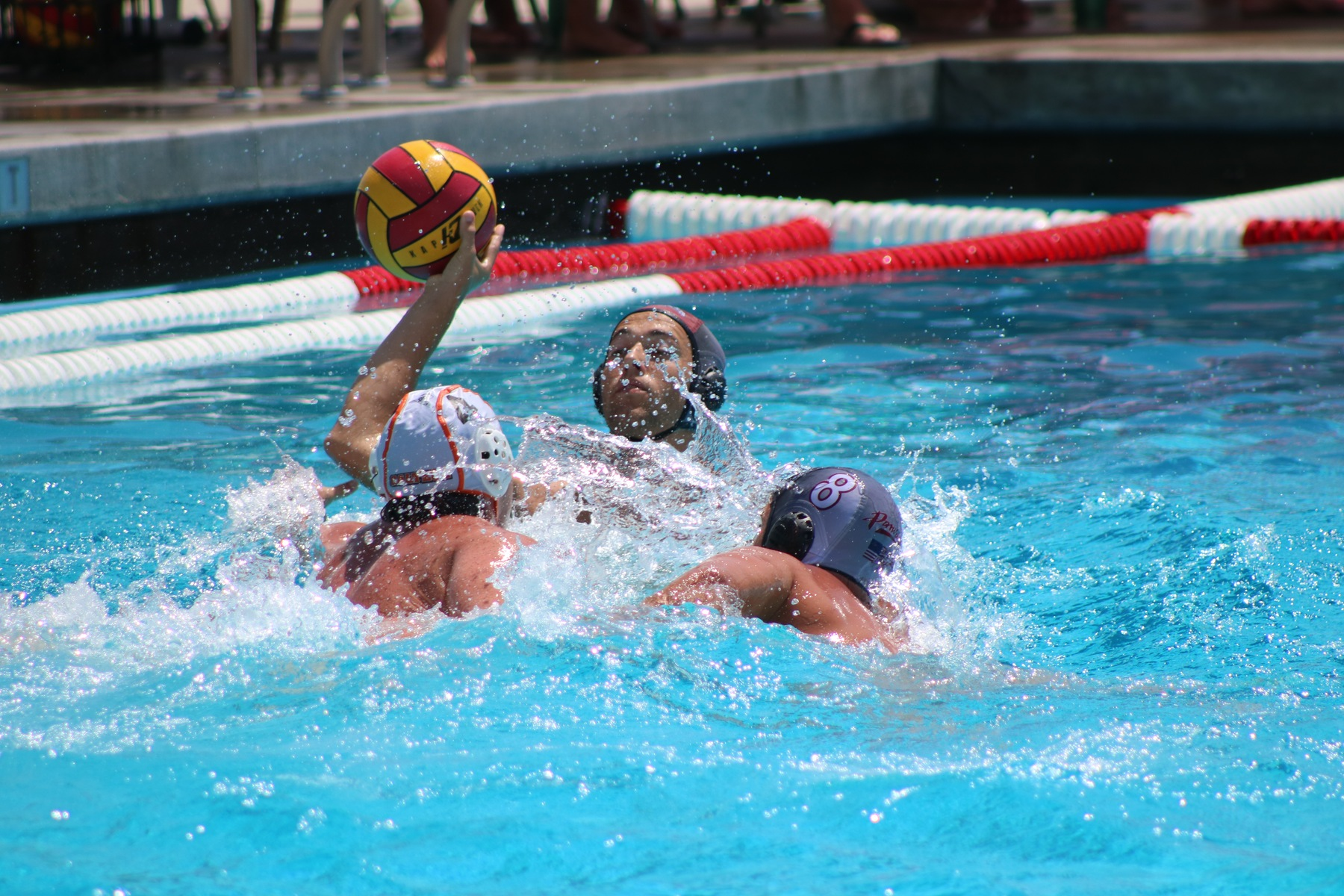 Men's water polo player going for a shot
