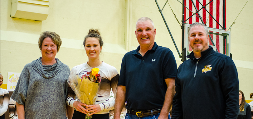 Senior Alicia Lortcher with parents and head coach Scott Carter on Seniors' and Parents' Day (Photo Courtesy of Lori Kumorek)