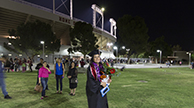 woman in cap and gown after graduation