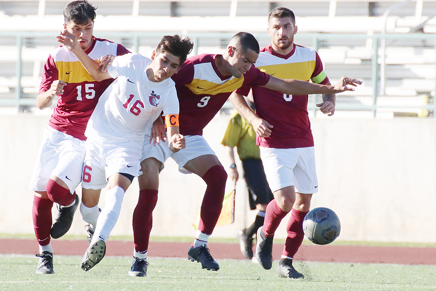 Lancer David Vasquez-Mena (9) fights for the ball in a recent game.
