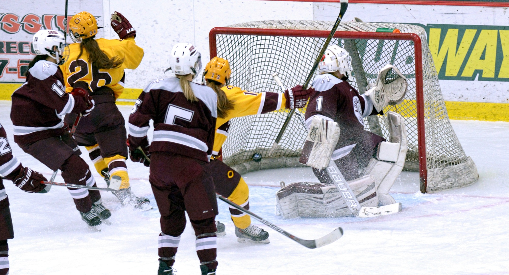 Tori Davis (#26) celebrates her breakaway goal in the first period in the Cobbers' 4-1 win over Augsburg.