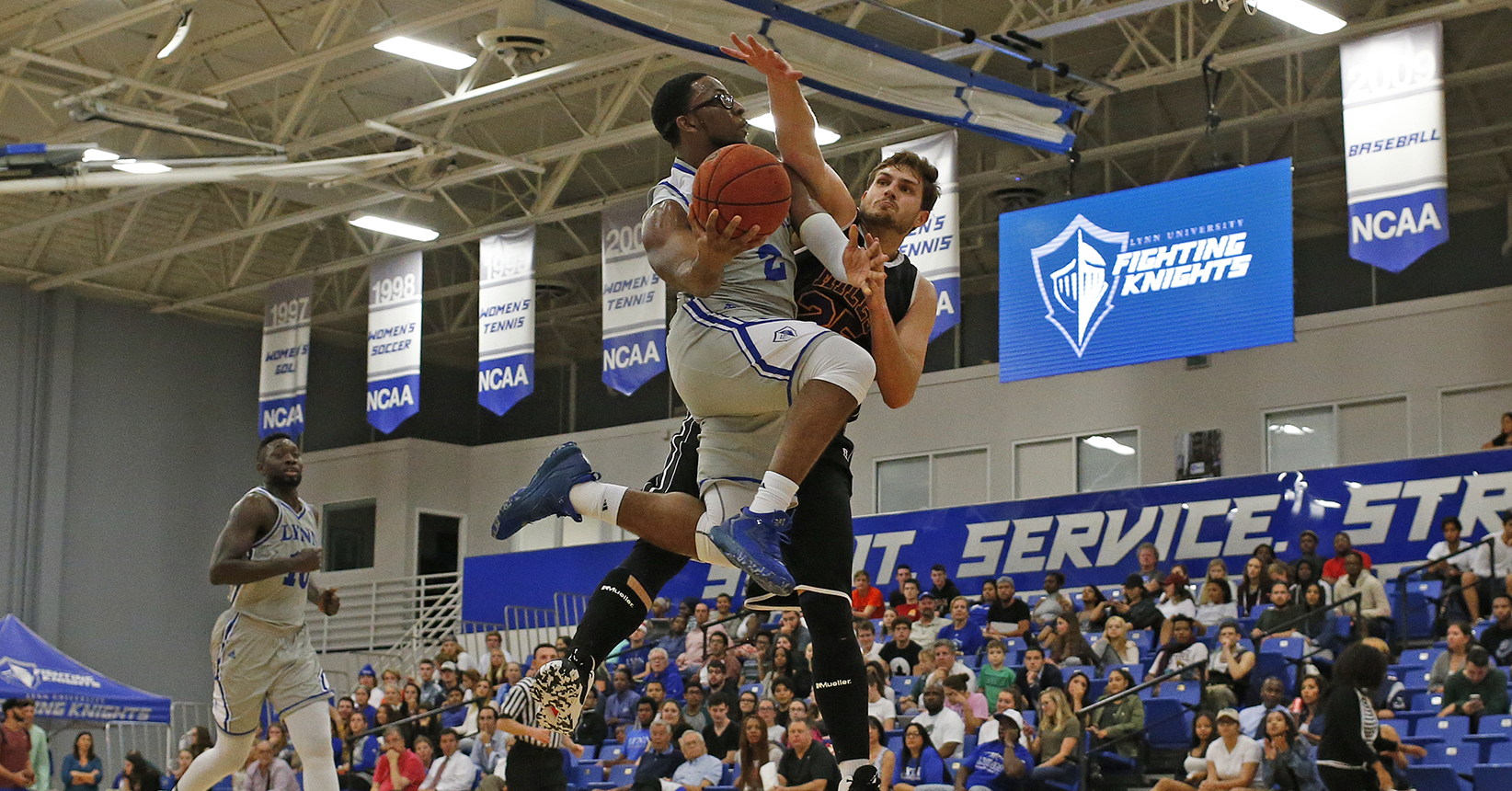 Palmer Sets the Pace in Men's Basketball Holiday Classic Victory