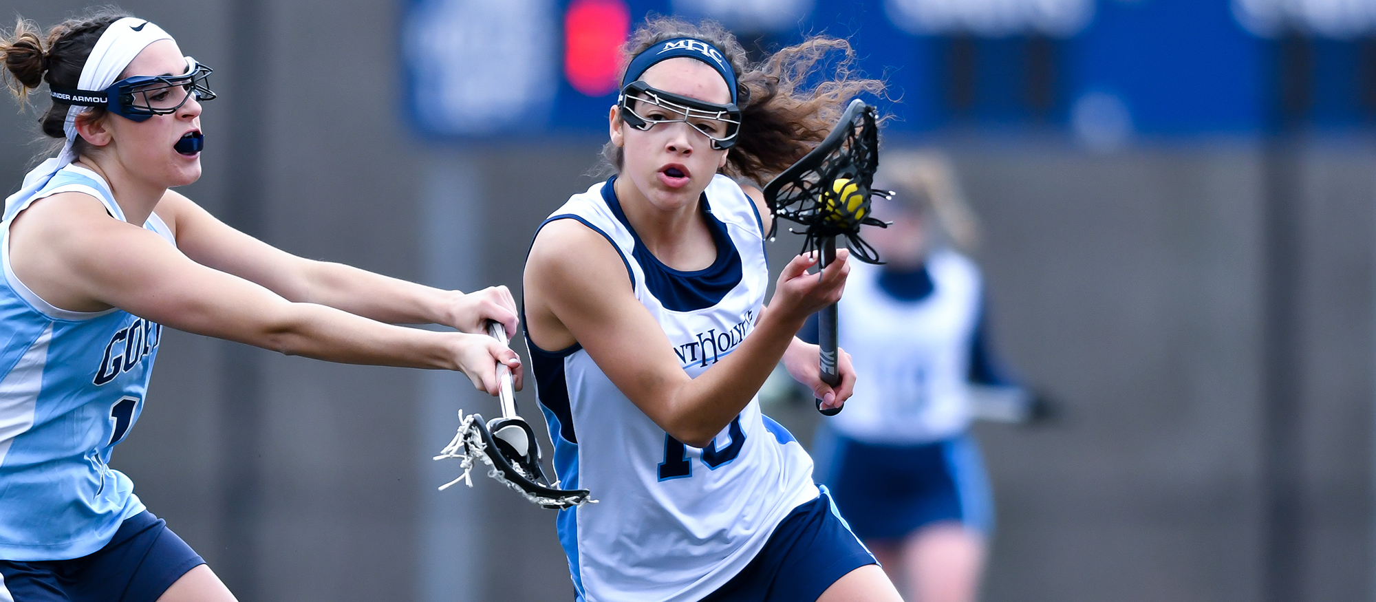 Action photo of Lyons lacrosse player, Julianna Rankin.
