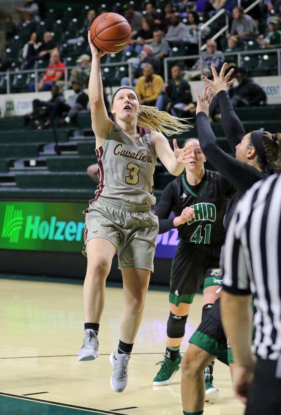 A Strong Defensive Second Quarter Boosts Walsh over Malone, 76-56