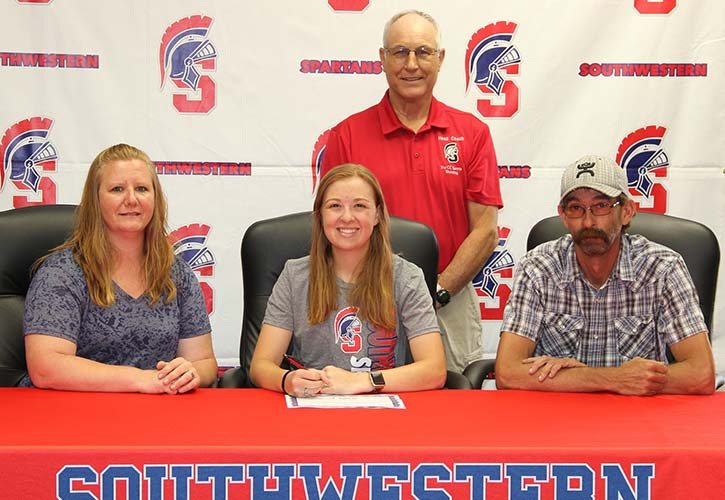 In photo (L to R):  Sitting – Donna Allen, Casey's mother; Casey Allen; and Shawn Allen, Casey's father. Standing - Marc Roberg, Southwestern Community College sports shooting coach.
