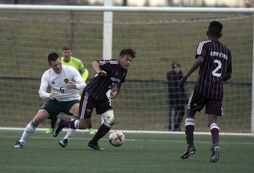 MacEwan's Christian Hernandez looks for space in the attacking third of the field against Alberta's Cameron Sjerve on Saturday (Chris Piggott photo).