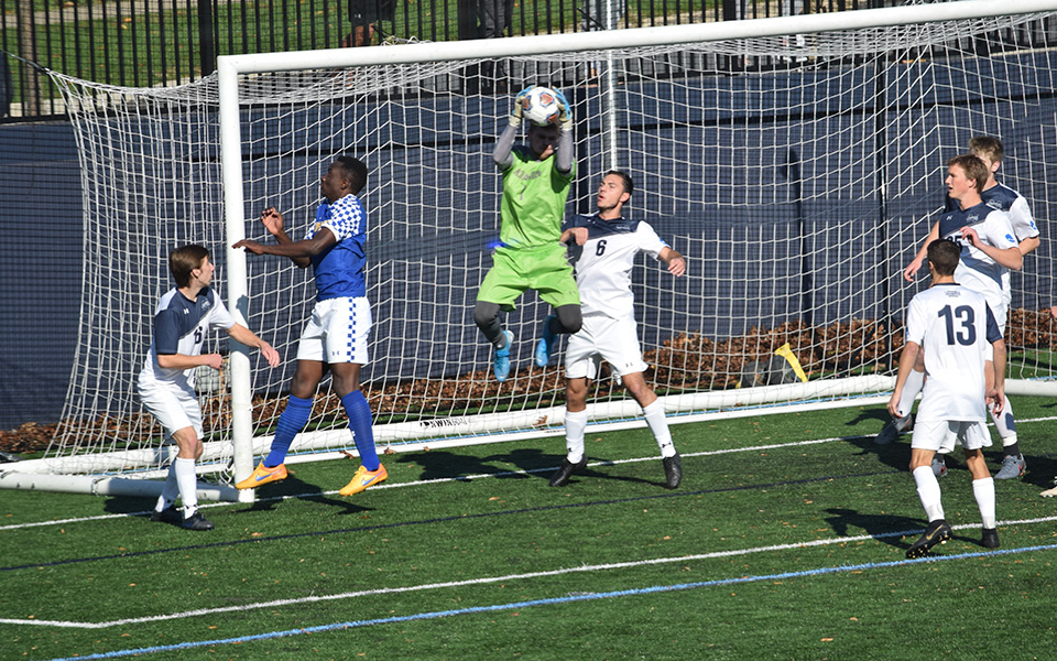 Junior Michael Bone jumps for the ball on a corner kick by Goucher College in the first half on John Makuvek Field.