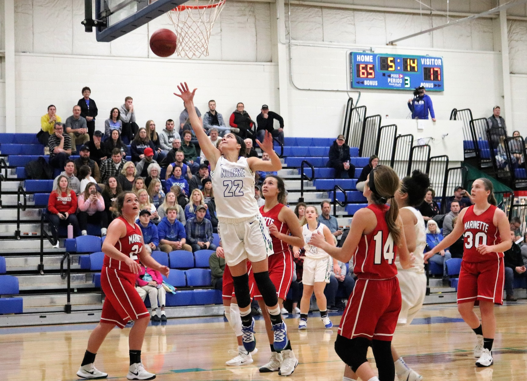 Brooke Dalgord shooting a layup surrounded by defenders