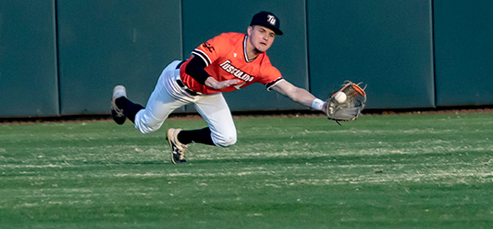 Seth DeHaven makes this diving catch to end the 3rd inning in Tusculum's 19-4 home win over King (photo by Chuck Williams)