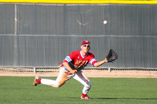 Hunter Bross makes a diving grab to take away a hit from Paradise Valley Tuesday afternoon. (photo by Aaron Webster)
