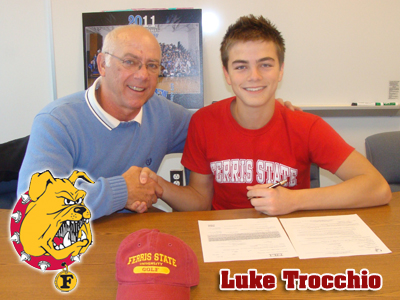 Luke Trocchio (right) is congratulated by his high school coach Dave Murray (left) after signing his national letter-of-intent with Ferris State.