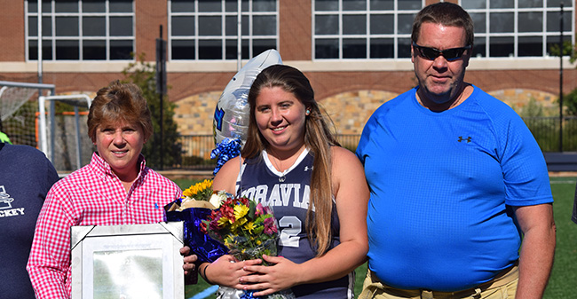 Senior Katie Morrison with her parents on Senior day prior to match with Susquehanna University.