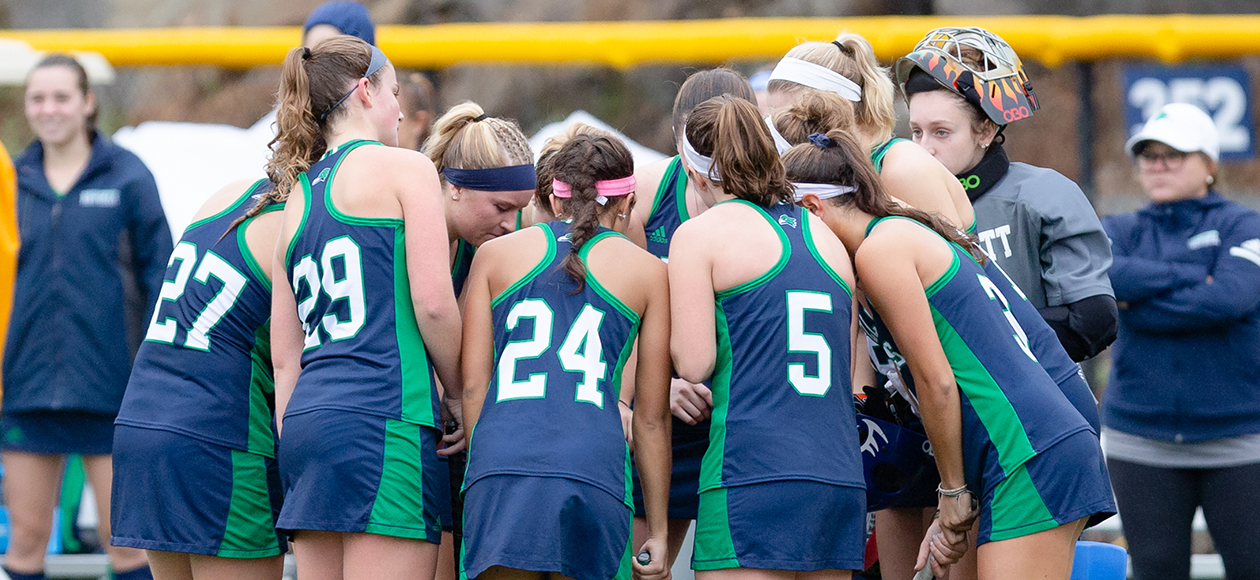 Endicott field hockey team huddle