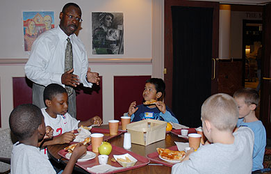SU coach Sherman Wood speaks with local youth.