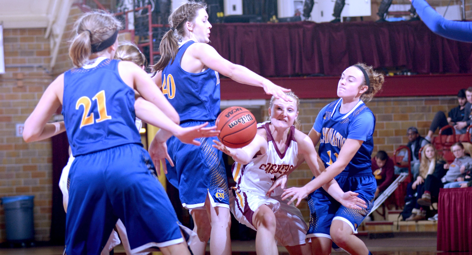 Senior Greta Walsh dishes the ball inside to one of the Cobber post players during the fourth quarter of Concordia's win against St. Scholastica.