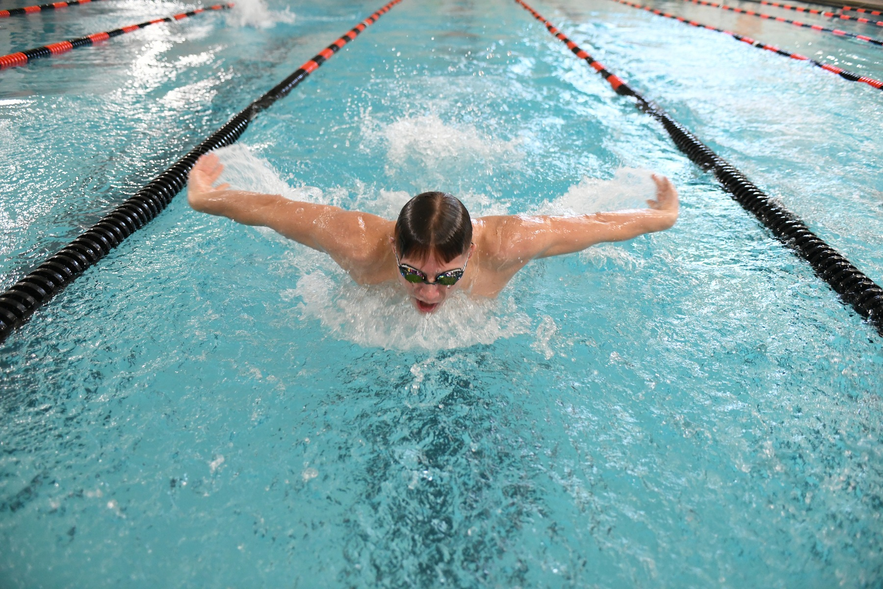 Cather Places 10th in 100 Butterfly at MAC Championships