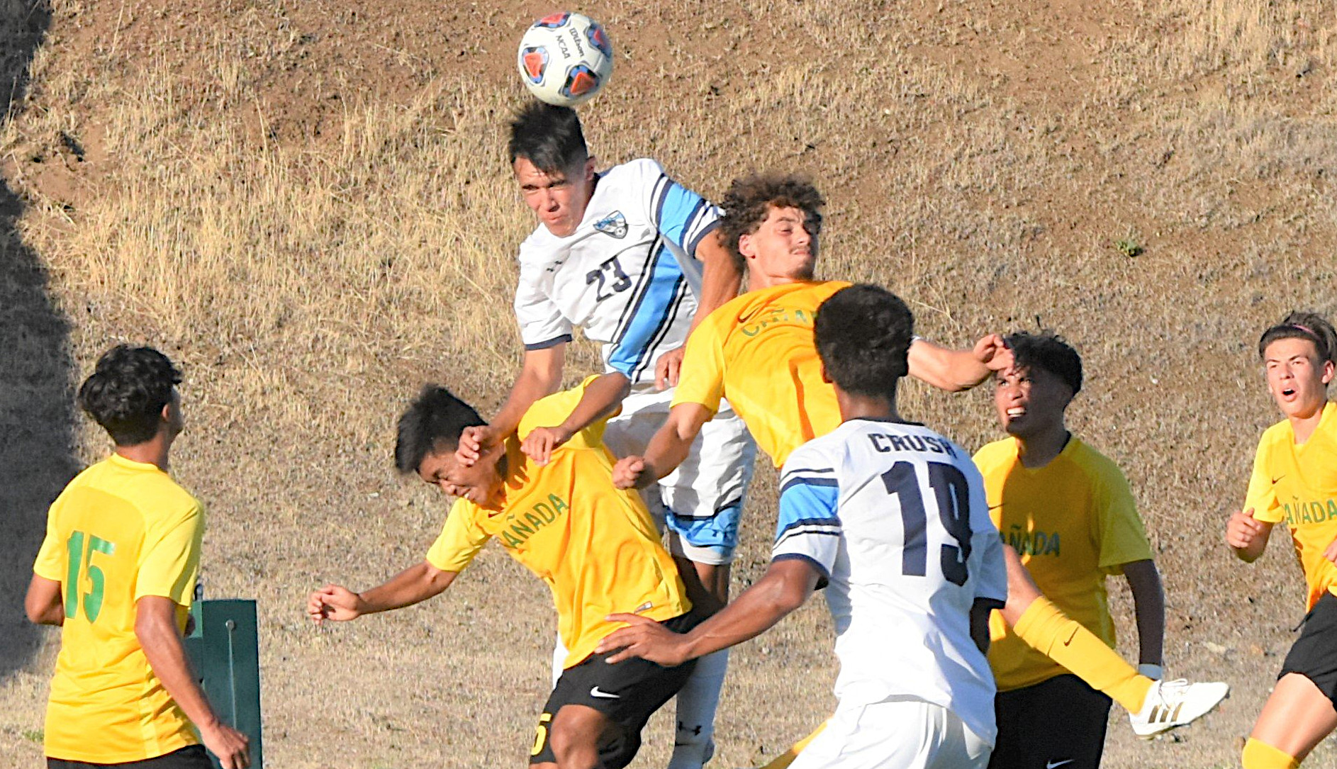 Ryan Rosas goes up for a header in Clovis' 2-1 loss at Cañada. (Photo by Lisa Graham/@ckkmomma)