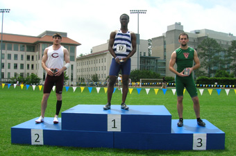 Vincent Asante '14 receives his medal for winning the 100-meter dash (courtesy Emory Sports Info)