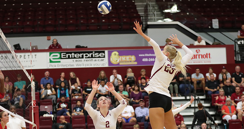 Jensen Cunningham (right) tallied career-high marks of 19 kills and 17 digs against Gonzaga on Thursday night.