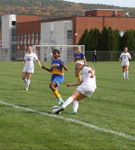SUNY Broome women's soccer player keeping ball inbounds