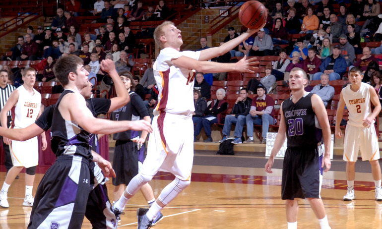 Cobber junior guard Corey Abbas goes in for the lay-up during Concordia's 86-58 win over Crown.