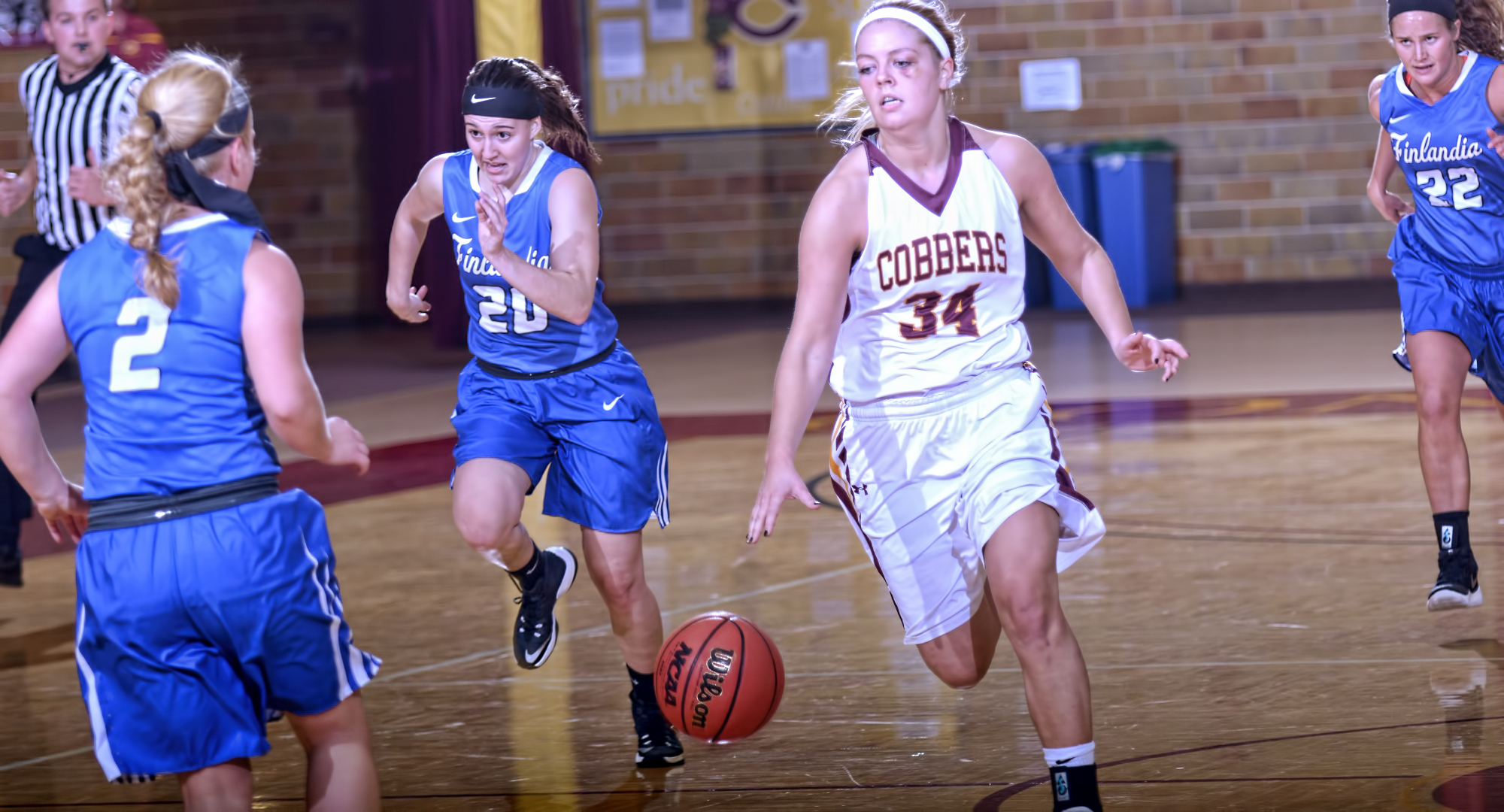 Junior Grace Wolhowe brings the ball up the court during the Cobbers' 95-52 win over Finlandia. Wolhowe finished with 13 points.