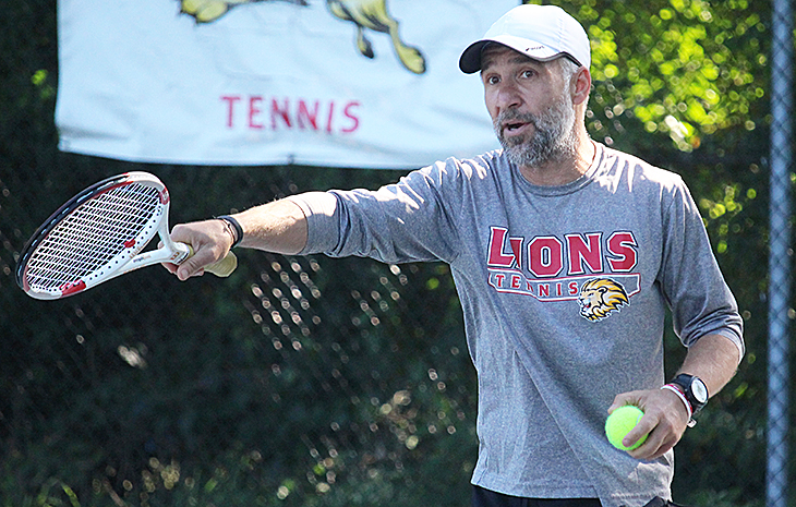 Men's Tennis Sweeps Regis 9-0; Cristian Popa Collects 200th Win