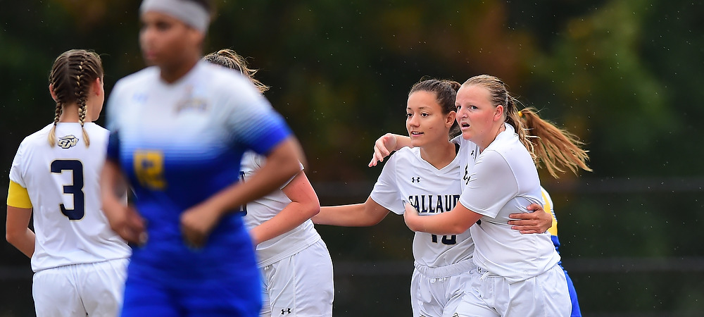 Gallaudet women's soccer players Brittany Mallach and Isabelle Troup hug after a Bison goal at Hotchkiss Field.