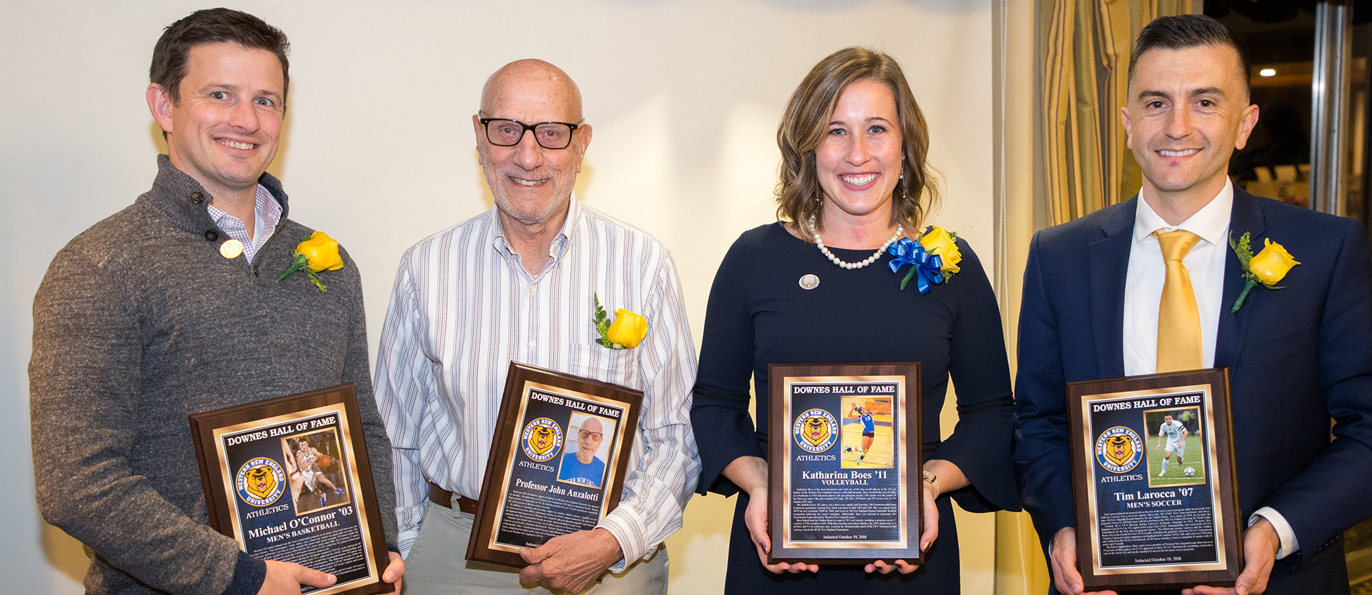From Left: Michael O'Connor '03 (men's basketball), Professor John Anzalotti (contributor), Katharina Boes '11 (volleyball) and Tim Larocca '07 (men's soccer) were inducted into the Downes Athletic Hall of Fame on Friday night. (Photo by Chris Marion)
