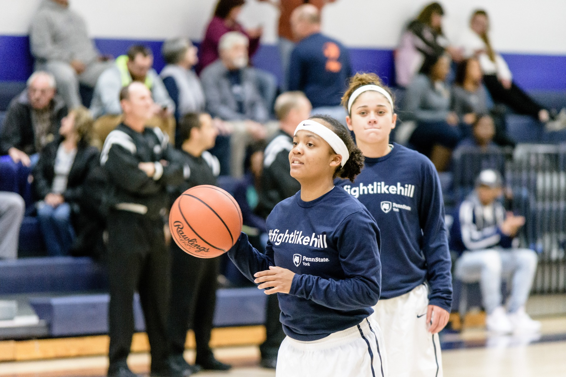 Charzima Johnson and Emily Colon warm up before the first annual Maddie Hill Basketball Games, last season.