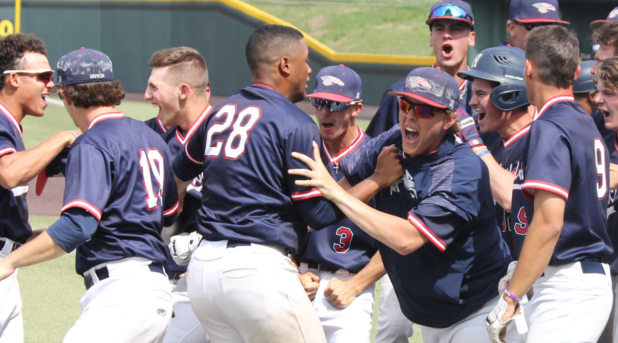 The Blue Dragons celebrate after Logan Sartori hit a two-run walk-off home run as Hutch rallies from eight runs down to defeat Cloud County 14-12 in an elimination game on Friday at Eck Stadium in Wichita. (Bre Rogers/Blue Dragon Sports Information)