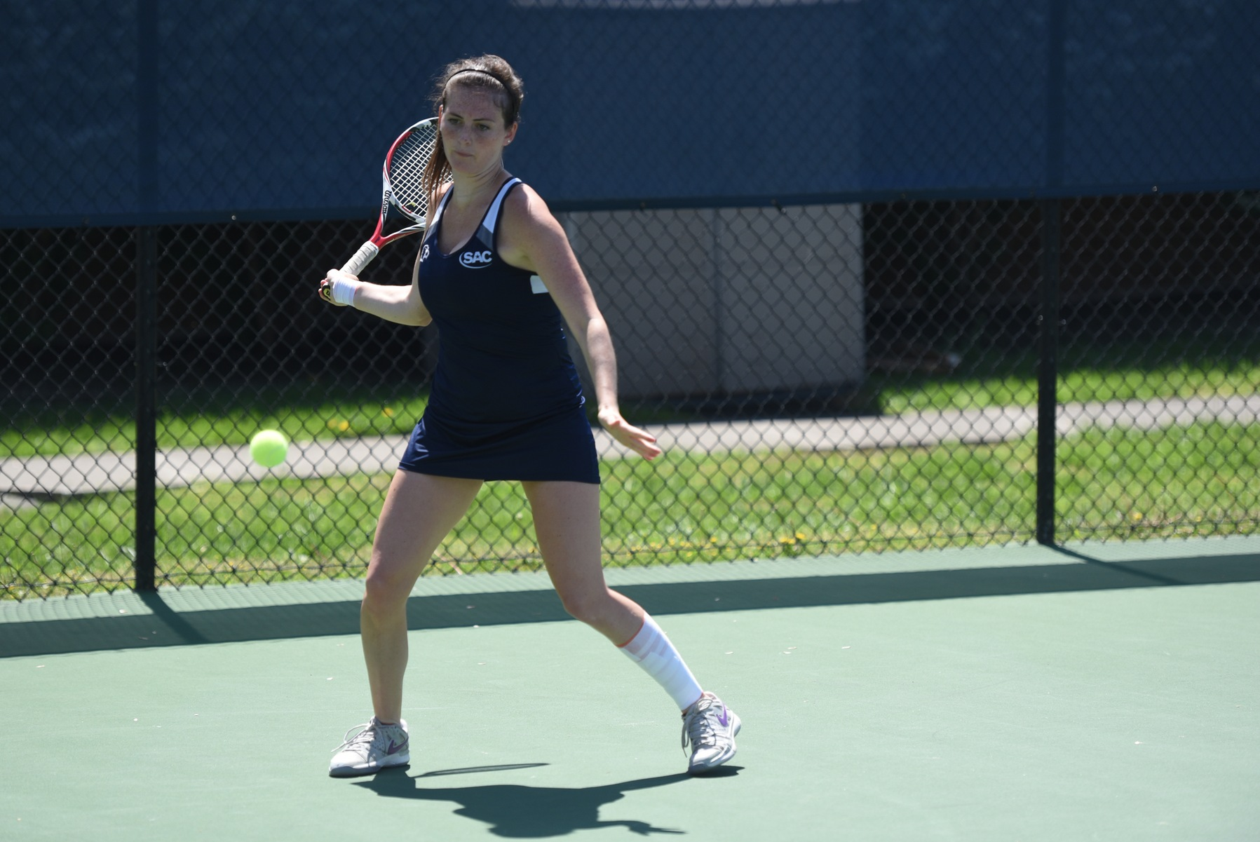 Queens overpowers Eagles in singles play