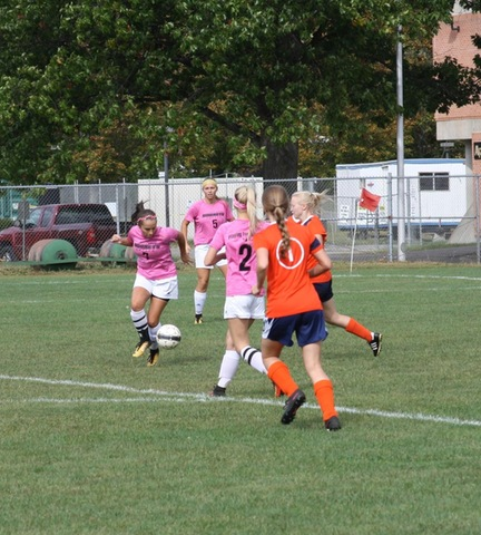 SUNY Broome women's soccer player dribbling around opponent