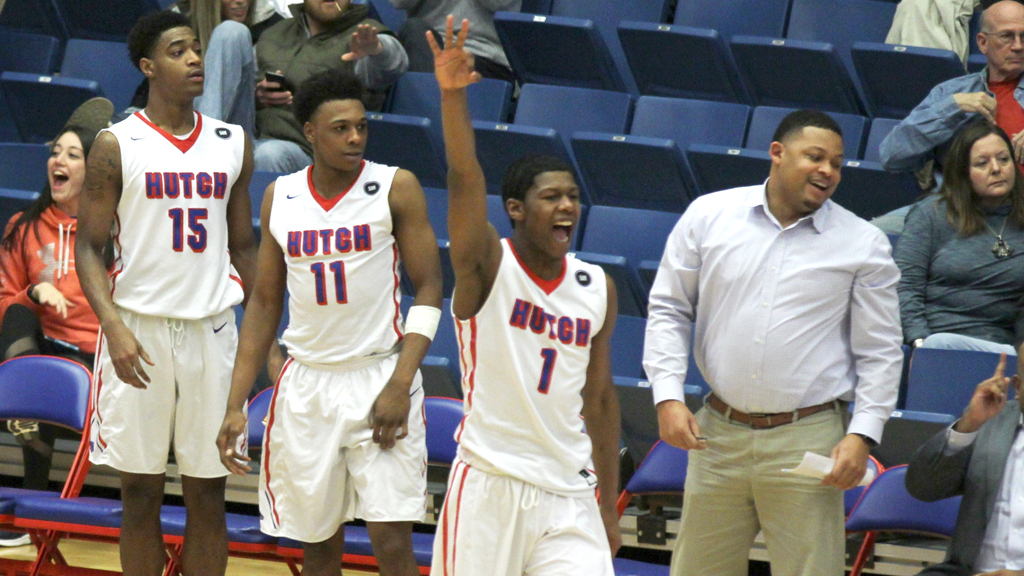The Blue Dragons celebrate a come-from-behind 60-57 victory over Pratt on Saturday at the Sports Arena. (Bre Rogers/Blue Dragon Sports Information)