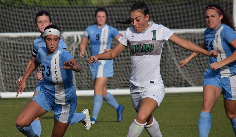 Wilmington University player Kelly Robbins (#1) beating the Holy Family's defenders to score the first goal of the game during their NCAA Division II Women's Soccer match at the Wilmington University sports complex in Newark, Delaware September 26, 2018. Photo by Eric Melchior