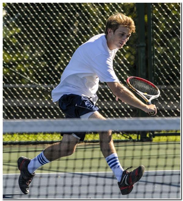 Lions' men's tennis team falls to Earlham College in rain-shortened match