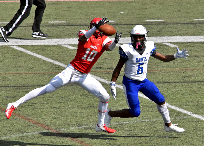 Defensive back Jarrett White makes an interception in Saturday's loss to Thomas More College.