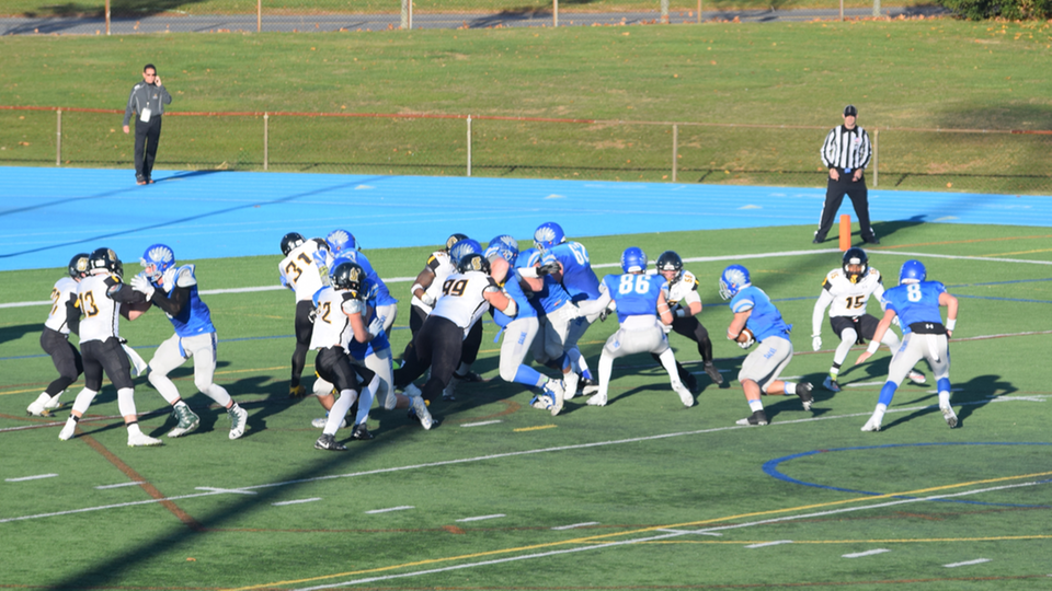 Framingham State defense (white jerseys) stopped Salve Regina on four straight plays in the final two minutes, after the Seahawks had 1st-and-goal from the seven-yard line, to hang on for a 37-34 victory in the New England Bowl. (Photo by Ed Habershaw)