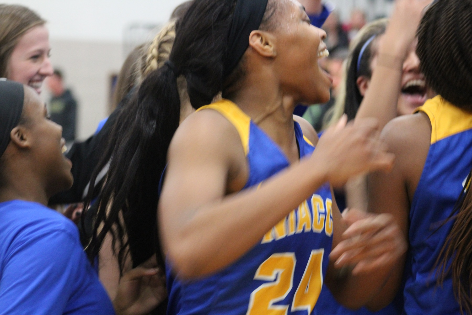 Khalilah Holloway celebrates after NIACC advanced to the regional title game with Thursday's 90-80 win over No. 11 DMACC.