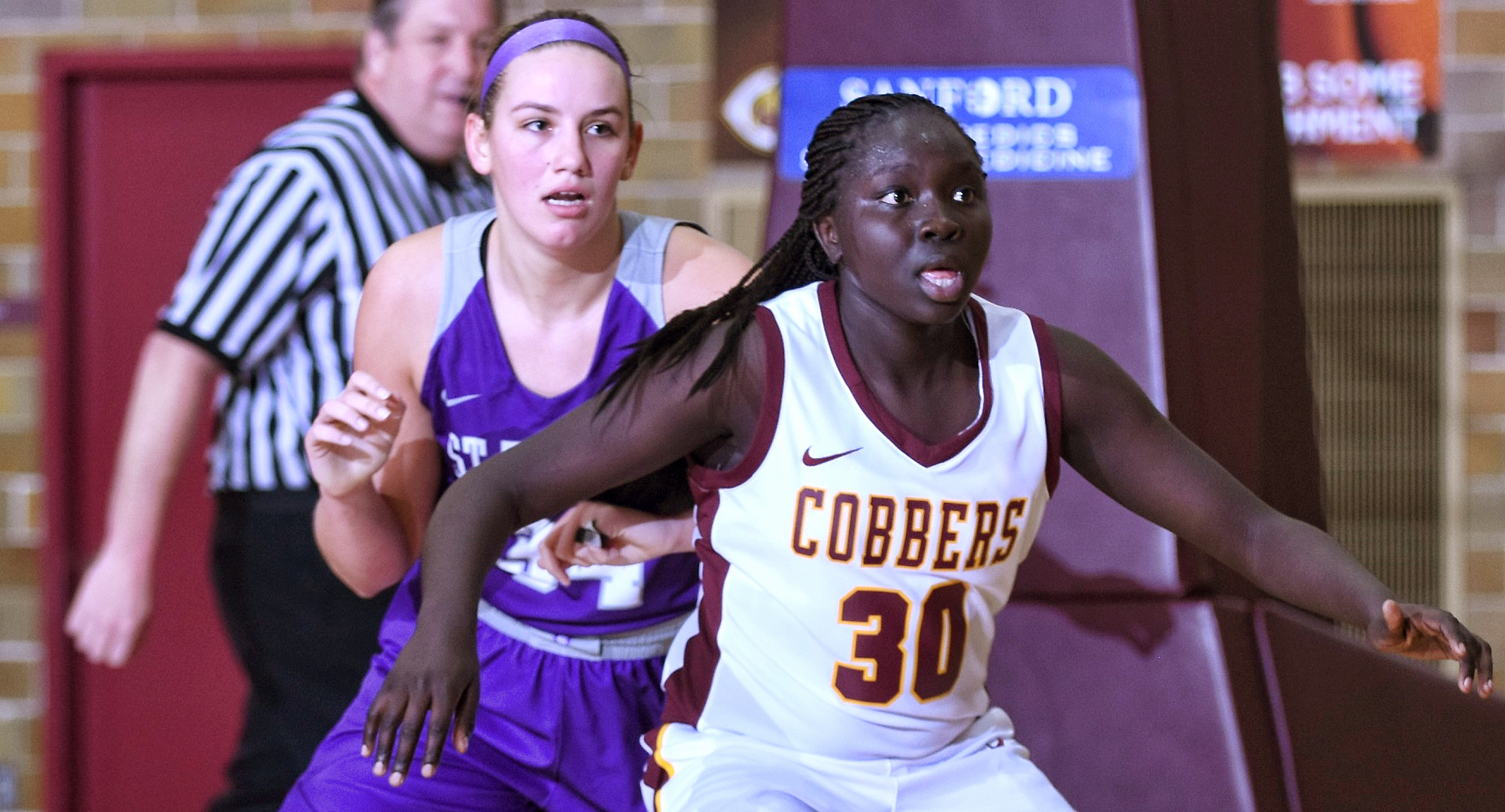 Sophomore Mary Sem posts up a St. Thomas player during the second half of the Cobbers' first game of 2020. Sem tied her career-high with 25 points.