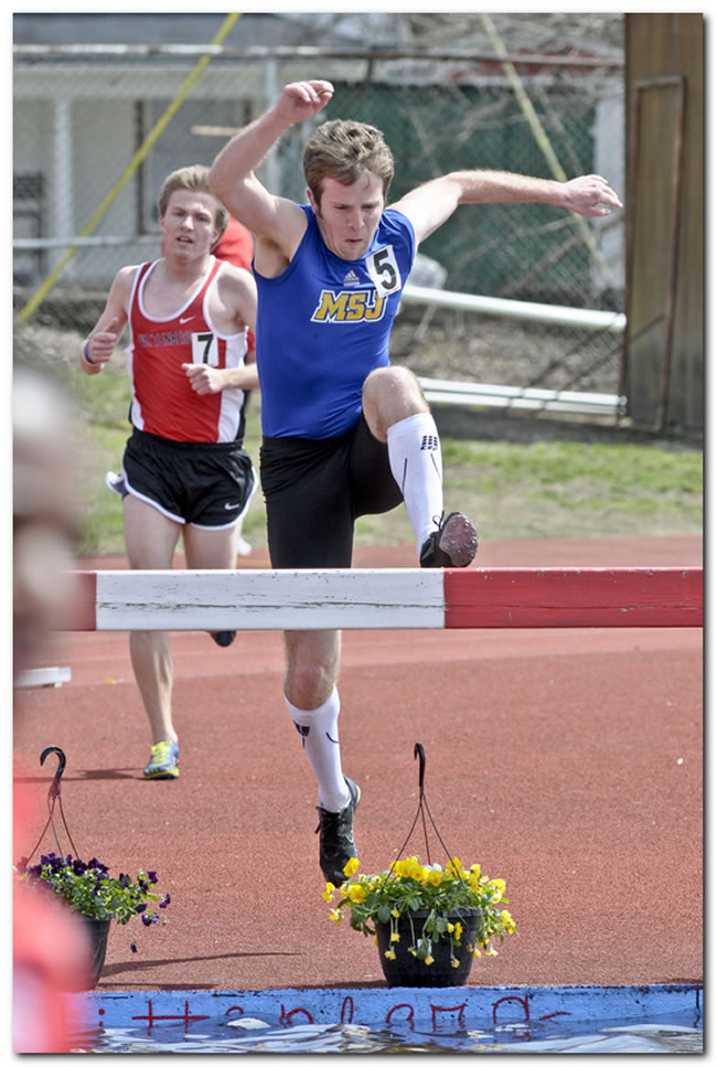 Lions' men's track & field team in action at the University of Indianapolis