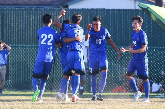 The Falcons celebrate after Christian Perez (13) scored the game-winning goal