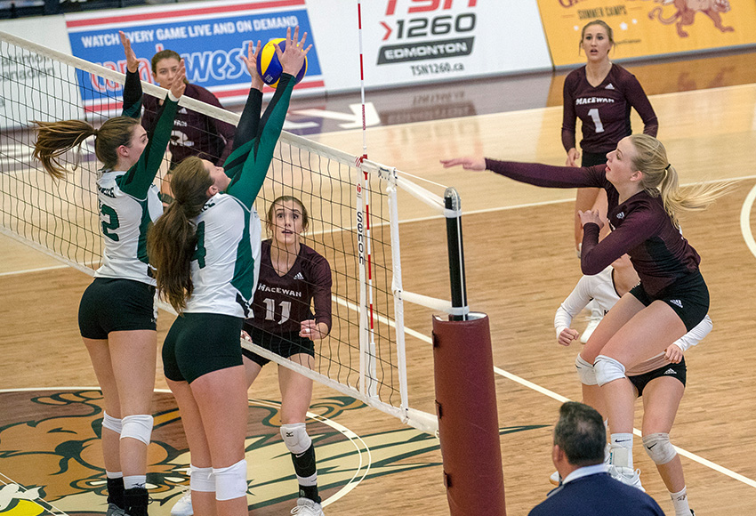 Hailey Cornelis hammers one from the left side for the Griffins on Saturday. She and Janna Ogle, #1 background, came up big for MacEwan in a 3-1 win (Eduardo Perez photo).