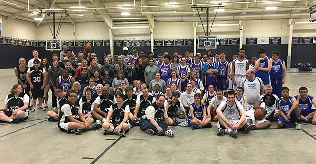 Participants and Moravian student-athlete volunteers after the 6th Annual Special Olympics Basketball Tournament in Timothy Breidegam Field House on April 22.