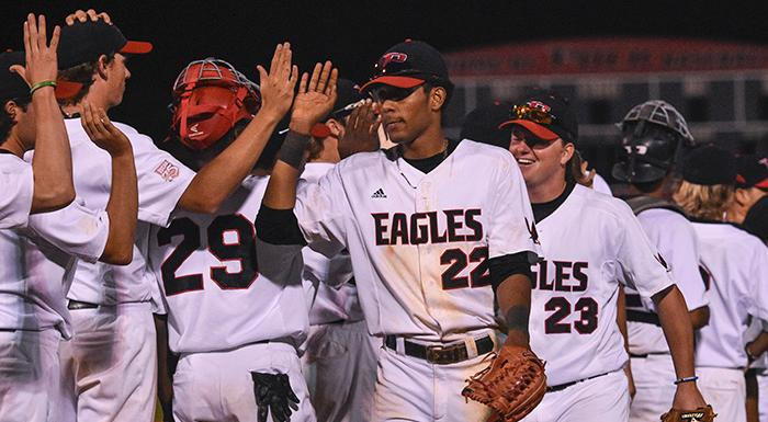 Raudy Martinez (22) and the Eagles celebrate after defeating St. Pete 10-5. Martinez had a walk, a single, a triple, and three RBI. (Photo by Tom Hagerty, Polk State.)