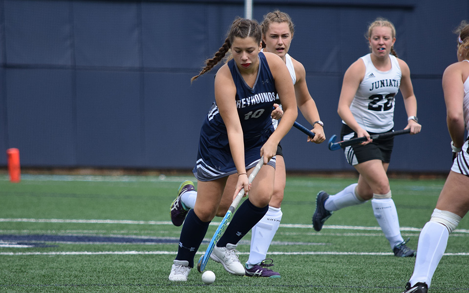 Ava Edwards dribbles the ball up field versus Juniata College on John Makuvek Field