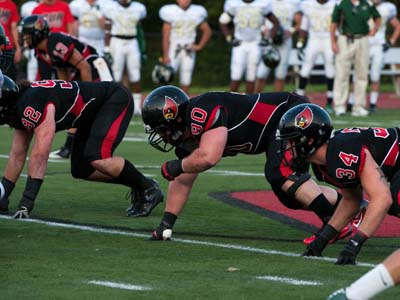 Cardinals force five turnovers to help lead CUA to 34-7 win