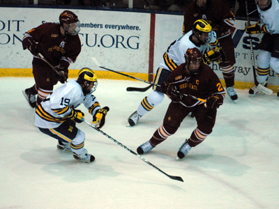 Zach Redmond (#24) and #19th-ranked Ferris State come up a goal short at #7 Michigan Friday night.  (Photo by Joe Gorby)